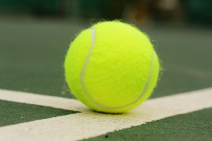 tennis-ball-on-surface-of-hard-court-f4